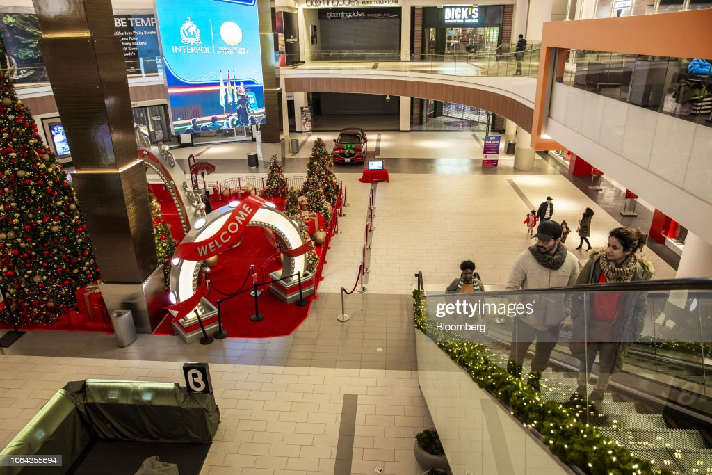 Shoppers ride an escalator inside the Simon Property Group Roosevelt
