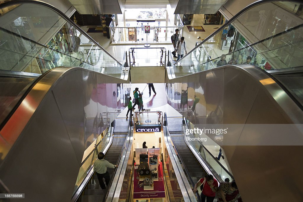 Shoppers ride escalators at a mall in Mumbai, India, on Tuesday, Nov. 6, 2012. Reserve Bank of India Governor Duvvuri Subbarao lowered the RBI's forecast for India's gross domestic product growth in the year through March to 5.8 percent, the slowest in almost a decade, from 6.5 percent. Photographer: Brent Lewin/Bloomberg via Getty Images