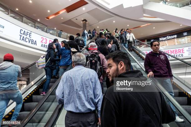 Shoppers ride escalators at the Forum Buenavista mall in Mexico City Mexico on Monday Nov 20 2017 The National Institute of Statistics and Geography...