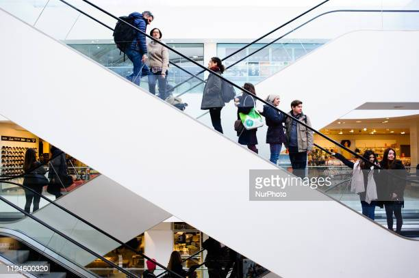 Shoppers ride up an escalator in the John Lewis flagship store on Oxford Street in London England on February 9 2019 February 15 sees the release of...
