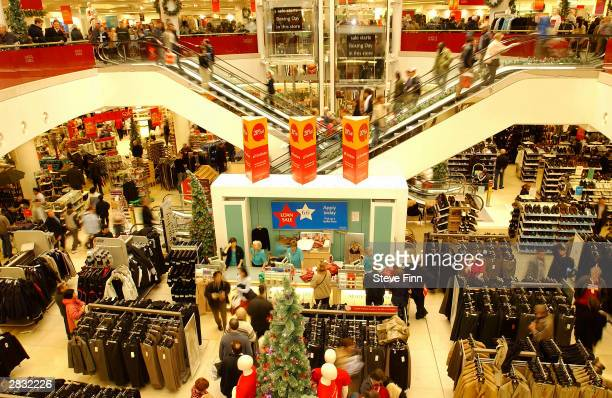 Shoppers rumage through the bargains at the Boxing Day sales at Blue Water Shopping Centre on December 26 2003 in Greenhithe England Thousands of...