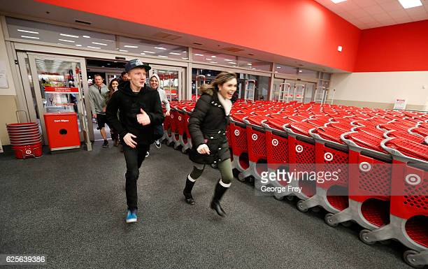 Shoppers run into Target as it opened for 'Black Friday' deals on November 24 2016 in Orem Utah Retailers kicked off the unofficial start of the...