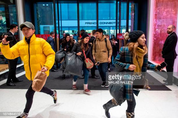 Shoppers run into the store as the doors open in Selfridges department store during the Boxing Day sale in central London on December 26 2018...