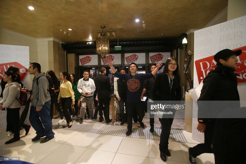 Shoppers run through the doors during the Boxing Day sales at the David Jones Market Street store on December 26, 2012 in Sydney, Australia. Boxing Day proves to be one of the busiest days for retail outlets in Sydney with thousands flocking to post-Christmas sales.