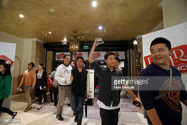 Shoppers run through the doors during the Boxing Day sales at the David Jones Market Street store on December 26 2012 in Sydney Australia Boxing Day...