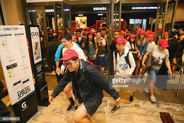 Shoppers rush into David Jones Castlereagh St store during the Boxing Day sales on December 26 2015 in Sydney Australia Boxing Day is one of the...