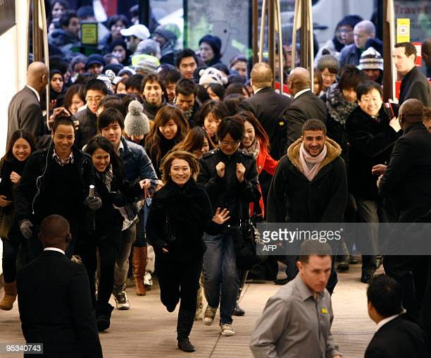 Shoppers rush into Selfridges as the store opens it doors on the first day of its winter sale on Boxing Day 2009 in London on December 26 2009 AFP...