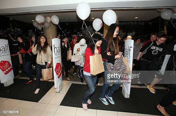 Shoppers rush into the store for the David Jones boxing day clearance sale at the Bourke Street Mall flagship store on December 26 2010 in Melbourne...