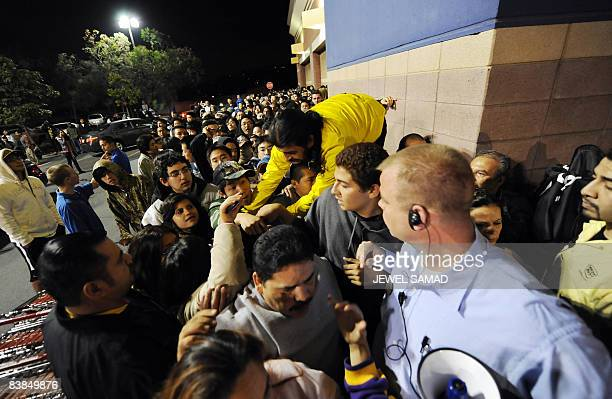 Shoppers rush to get in a BestBuy store at 5 am on November 28 2008 in Los Angeles California a day after Thanksgiving Thousands of shoppers queued...