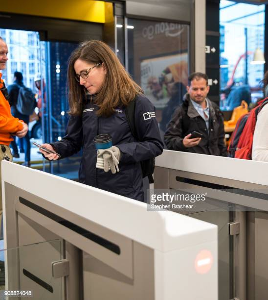 Shoppers scan the Amazon Go app on the mobile devices as the enter the Amazon Go store on January 22 2018 in Seattle Washington After more than a...
