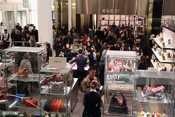 Shoppers scramble to buy cut price handbags in Selfridges ahead of the Boxing Day sales on December 26 2015 in London England Boxing Day is one of...
