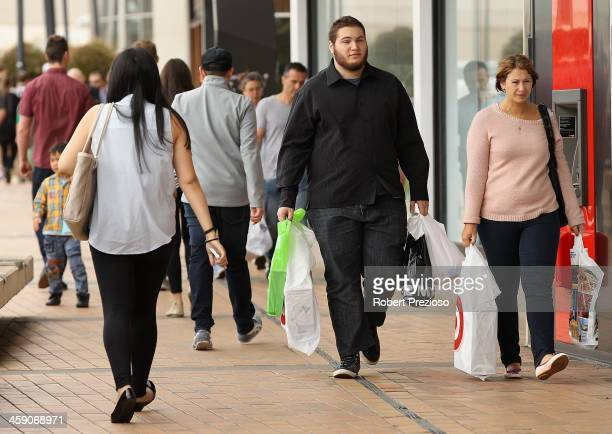 Shoppers search for items on December 23 2013 in Melbourne Australia Chadstone shopping Centre is open for 34 hours straight from today until...