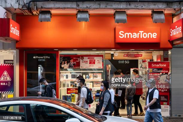 Shoppers seen inside Telecommunications mobile network company SmarTone in Hong Kong.
