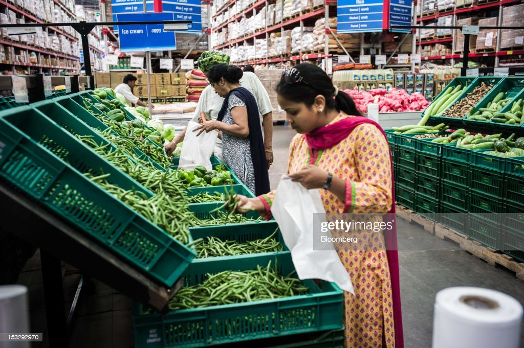 Shoppers select produce in the fruit and vegetable section of a Bharti Walmart Pvt Ltd Best Price Modern Wholesale store in Zirakpur on the outskirts.