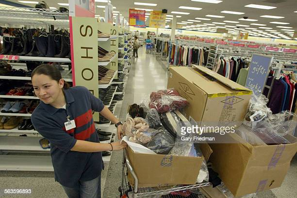 Shoppers shop at the Ross Dress for Less store in Pico Rivera shop on 11/14/75. CYNTHIA URIAS IS BEGINNING TO STOCK THE SHELVES WITH ACCESSORIES.