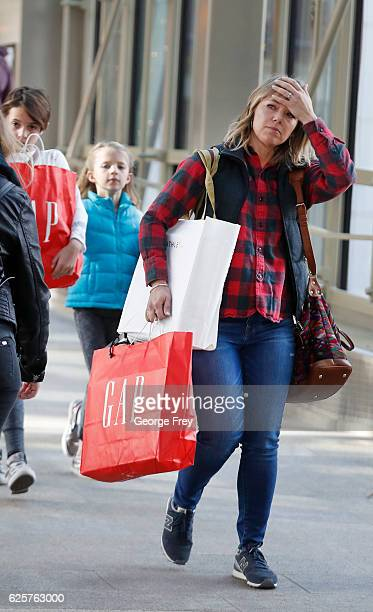 A shoppers shows her frustration a she walk through the City Creek Center with several bags looking for 'Black Friday' deals on November 25 2016 in...
