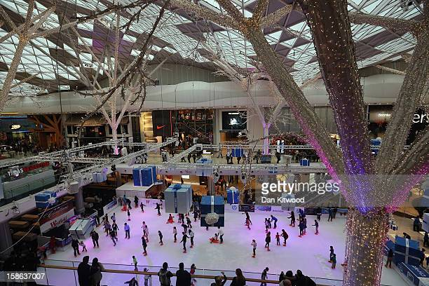 Shoppers skate in the ice rink in Westfield Shopping centre in West London on December 22 2012 in London England Today is the final Saturday before...