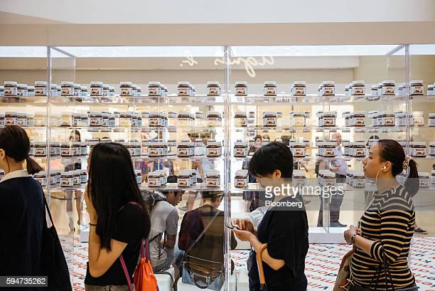 Shoppers stand in line at a Ferrero SpA's Nutella pop up store inside Pacific Place shopping mall in the Admiralty district of Hong Kong China on...