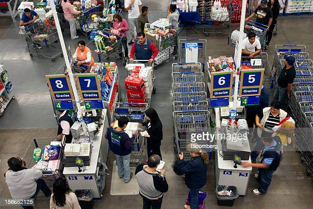 Shoppers stand in line to pay for their merchandise inside a Sam's Club store in Mexico City Mexico on Saturday Nov 17 2012 El Buen Fin Mexico's...