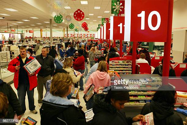 Shoppers stand inline to checkout at a Target on November 25 2005 in Hobart Indiana The day after Thanksgiving known as 'Black Friday' is...