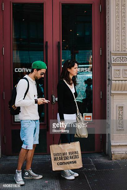 Shoppers stand outside the Converse Inc store in the SoHo neighborhood of New York US on Wednesday June 18 2014 The Bloomberg Consumer Comfort Index...