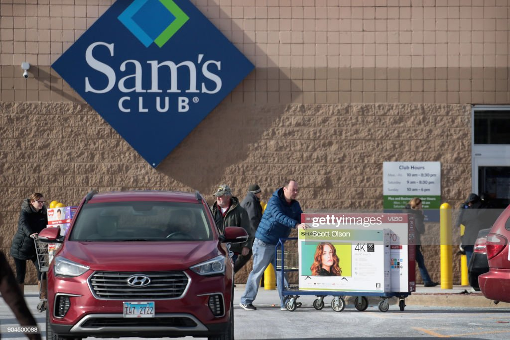 Shoppers stock up on merchandise at a Sam's Club store on January 12, 2018 in Streamwood, Illinois. The store is one of more 60 sheduled to close nationwide by the end of January.