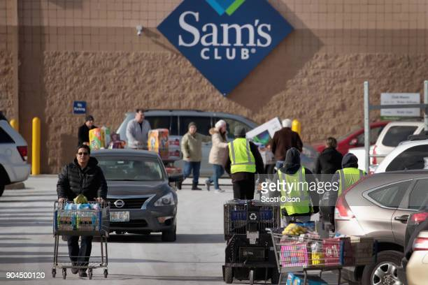 Shoppers stock up on merchandise at a Sam's Club store on January 12, 2018 in Streamwood, Illinois. The store is one of more 60 sheduled to close...