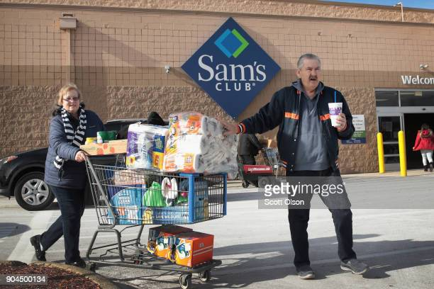 Shoppers stock up on merchandise at a Sam's Club store on January 12 2018 in Streamwood Illinois The store is one of more 60 sheduled to close...