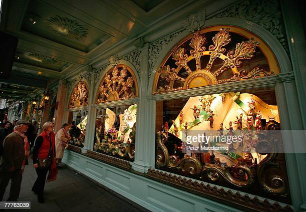 Shoppers stop to look at the newly decorated Christmas window displays at Fortnum Mason department store on November 7 2007 in Piccadilly London Six...