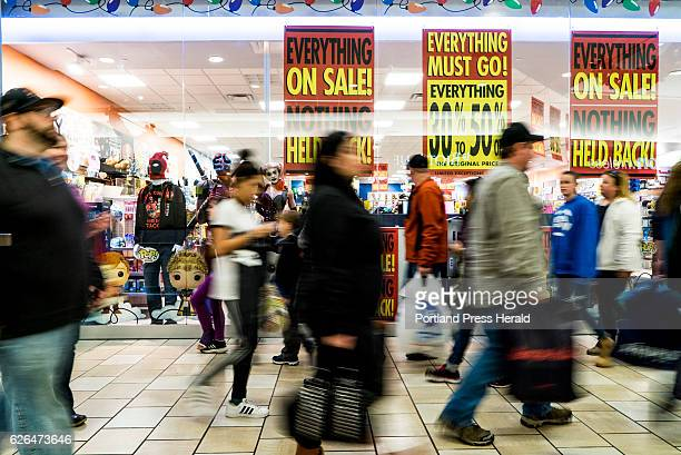 Shoppers stream past advertisements for Black Friday sales at the Maine Mall in South Portland Friday November 25 2016