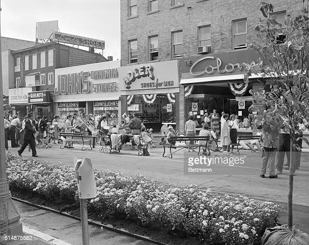 Shoppers stroll up and down Main Street in Hempstead New York The street has been closed to automobile traffic Front and Fulton avenues in an...