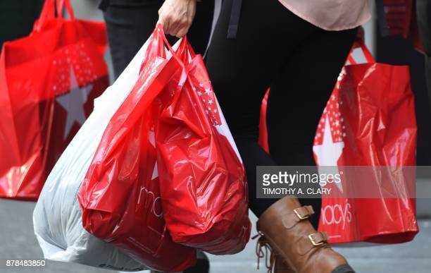 Shoppers take advantage of Black Friday sales the day after Thanksgiving in New York City November 242017 The Christmas shopping season kicks into...
