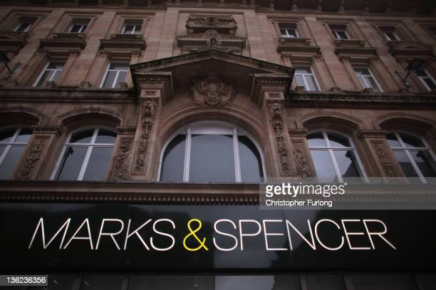 Shoppers take advantage of the post Christmas sales outside the Liverpool branch of Marks Spencers on December 29 2011 in Liverpool England In spite...