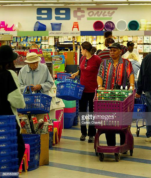 Shoppers take advantage of the the price at the $99 cent store in Los Angeles finding everthing from planters to toys and auto parts A bit everthing...