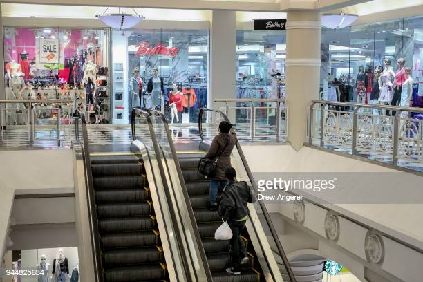 Shoppers take the escalator in the Manhattan Mall in the Herald Square neighborhood of Manhattan April 11 2018 in New York City US consumer prices...