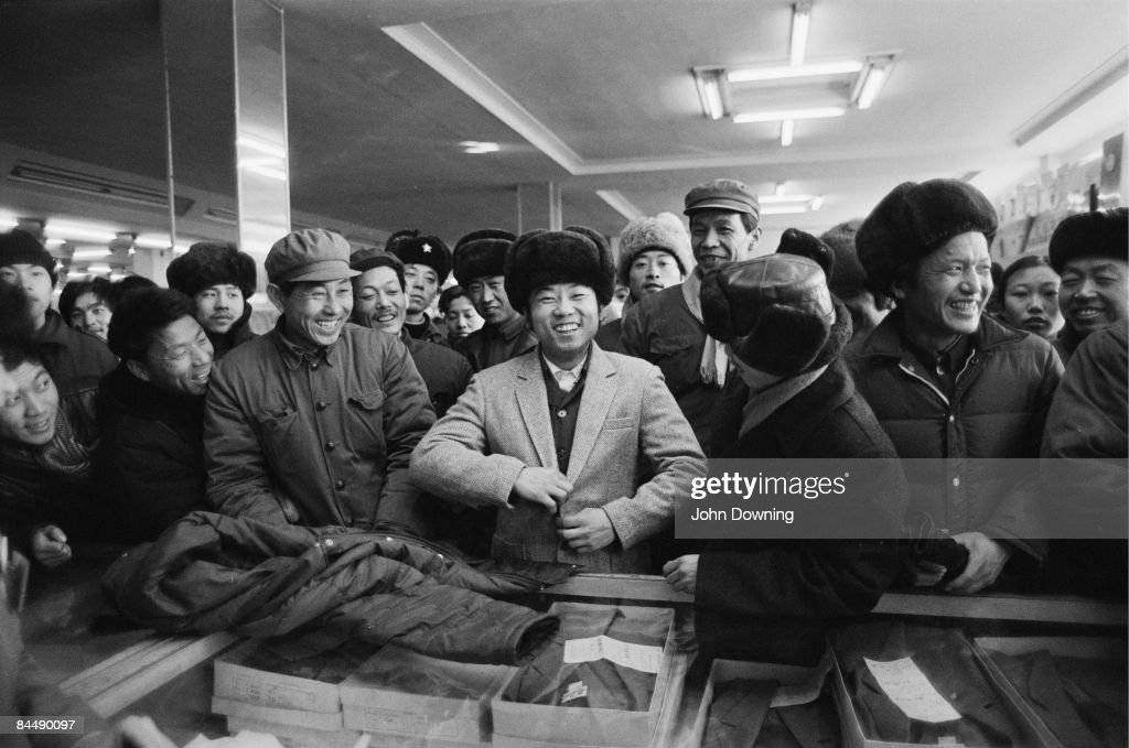 Shoppers try on items of western-style clothing at a store in China, 5th February 1985.