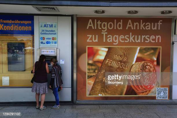 Shoppers use an automated teller machine in Berlin, Germany, on Thursday, July 29, 2021. Germany reports gross domestic product figures on July 30....