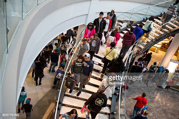 Shoppers use stairs at the Menlo Park Mall in Edison, New Jersey, U.S., on Friday, Nov. 25, 2016. As Black Friday ushers in the year-end shopping...