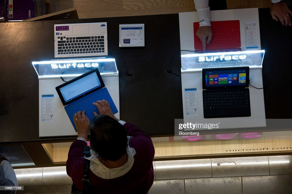 A shoppers uses a Microsoft Corp. Surface tablet computer at a pop-up store in the Westfield San Francisco Centre in San Francisco, California, U.S., on Friday, Nov. 23, 2012. To get shoppers to spend more than last year, retailers have continued to turn Black Friday, originally a one-day event after Thanksgiving, into a week's worth of deals and discounts. Photographer: David Paul Morris/Bloomberg via Getty Images