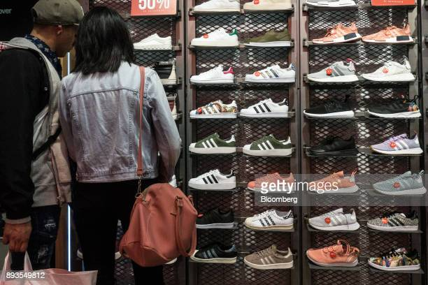 Shoppers view sneakers displayed for sale at the Forum Buenavista mall in Mexico City Mexico on Monday Nov 20 2017 The National Institute of...