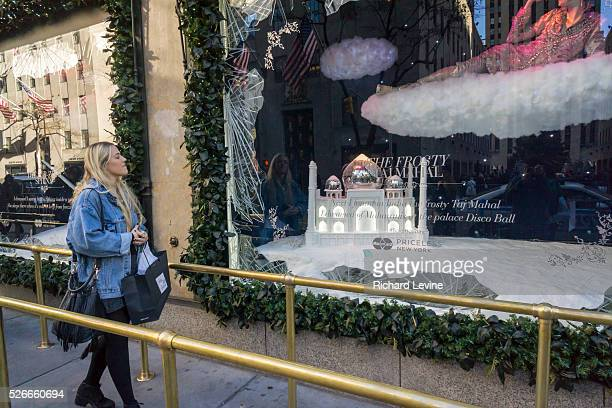 Shoppers view the Christmas windows of Saks Fifth Avenue in New York over the Black Friday weekend. The National Retail Federation reported that many...