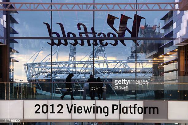 Shoppers view the London 2012 Olympic Stadium from Westfield Stratford City Shopping centre on October 25 2012 in Stratford England The Office for...