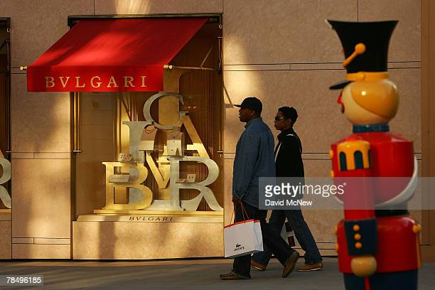 Shoppers visit businesses that cater to high-end luxury item consumers along Rodeo Drive on December 14, 2007 in Beverly Hills, California. In the...