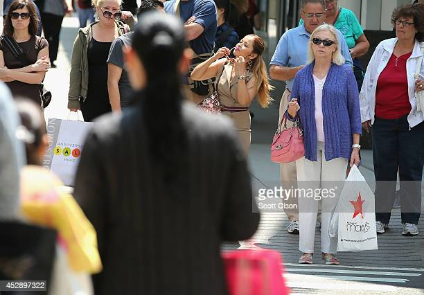 Shoppers visit stores along a section of Michigan Avenue known as the Magnificent Mile on July 29 2014 in Chicago Illinois As the job market...