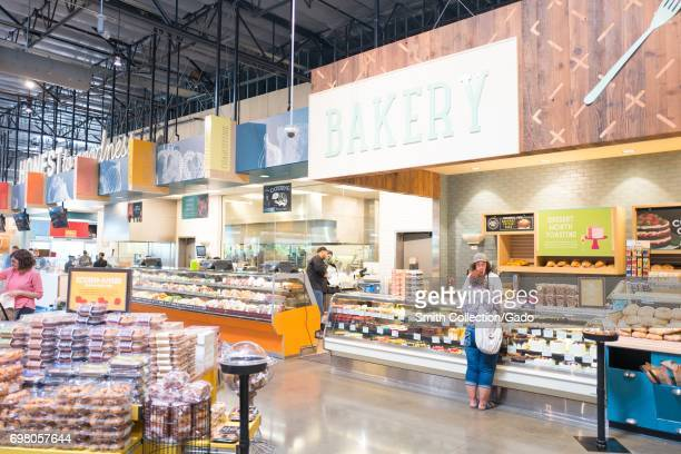 Shoppers visit the bakery section at the Whole Foods Market grocery store in Dublin California June 16 2017