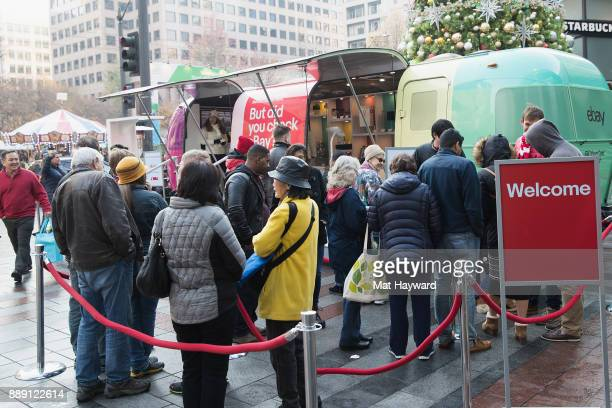 Shoppers visit the 'Did You Check eBay' Holiday Airstream tour at Westlake Center Plaza on December 9 2017 in Seattle Washington