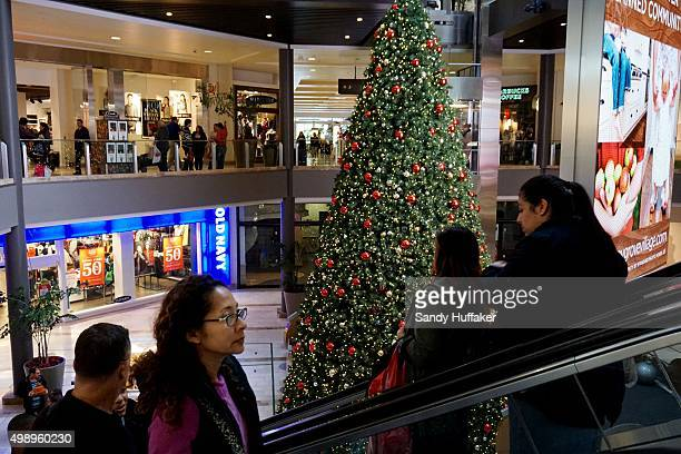 Shoppers visit the North County Fair Mall on November 27 2015 in Escondido California Although Black Friday sales are expected to be strong many...