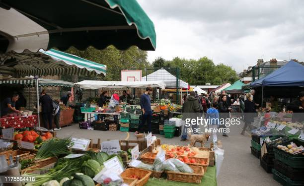 Shoppers visit the stalls at The Spread farmers' market in Primrose Hill north west London on October 5 2019 Brexit supporters have said the...