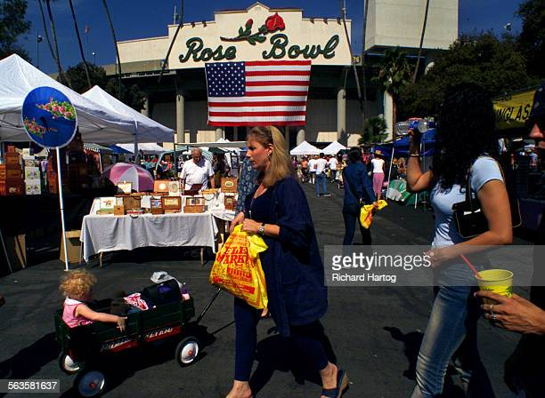 Shoppers wade through booths at the the Rose Bowl Flea Market Sunday afternoon in Pasadena Flea Markets are a recession proof business As many...