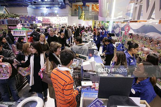 Shoppers wait at the cashiers at the Toys R Us store the day after Thanksgiving November 24 2006 in New York City Many shoppers venture out for early...